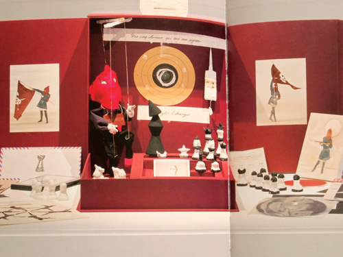 A red box fpr Marcel, 2013. Fabric, acrylic, wood, plaster, metal, paper, photographs, Polaroid, vinyl record, collage, and string, 13 x 50,2 x 45 cm